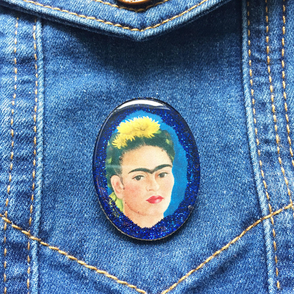 Glittery Frida Brooch on Denim background