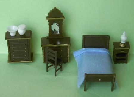 Set of 1/48th scale brown plastic furniture for the bedroom