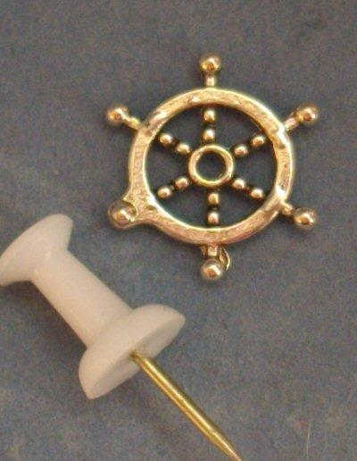 Miniature metal ships wheel suitable as a decorative item in 1/48th or 1/24th scale.