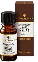 brown glass bottle with black cap, white label showing aromatherapy blend relax