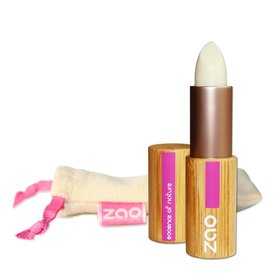 Open lip balm stick in bamboo tube, natural cotton pouch shown behind, label shows ZAO