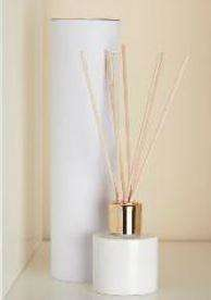 tall white cardboard box tube, white ceramic pot with gold top and reeds
