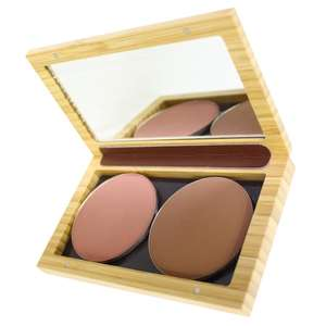 open bamboo make up case with mirrored lid. Two powdered make up refills inside.