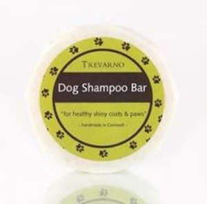 white paper wrapped soap bar, green label with brown paw prints, brown label white text Trevarno Dog Shampoo Bar
