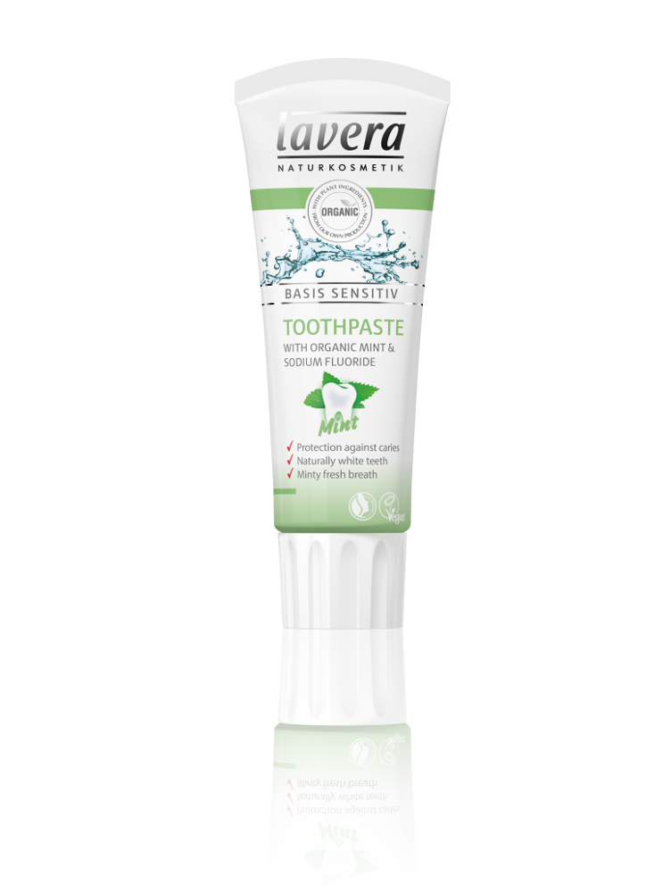 white plastic squeezy tube with white lid, green labelling showing mint toothpaste