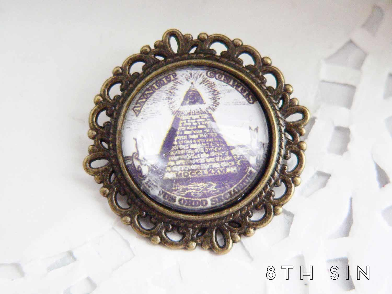 antique bronze all seeing eye brooch