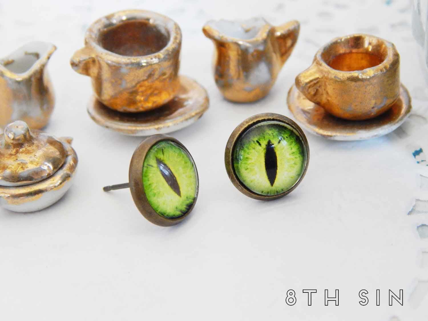 antique bronze and green dragon eye stud earrings