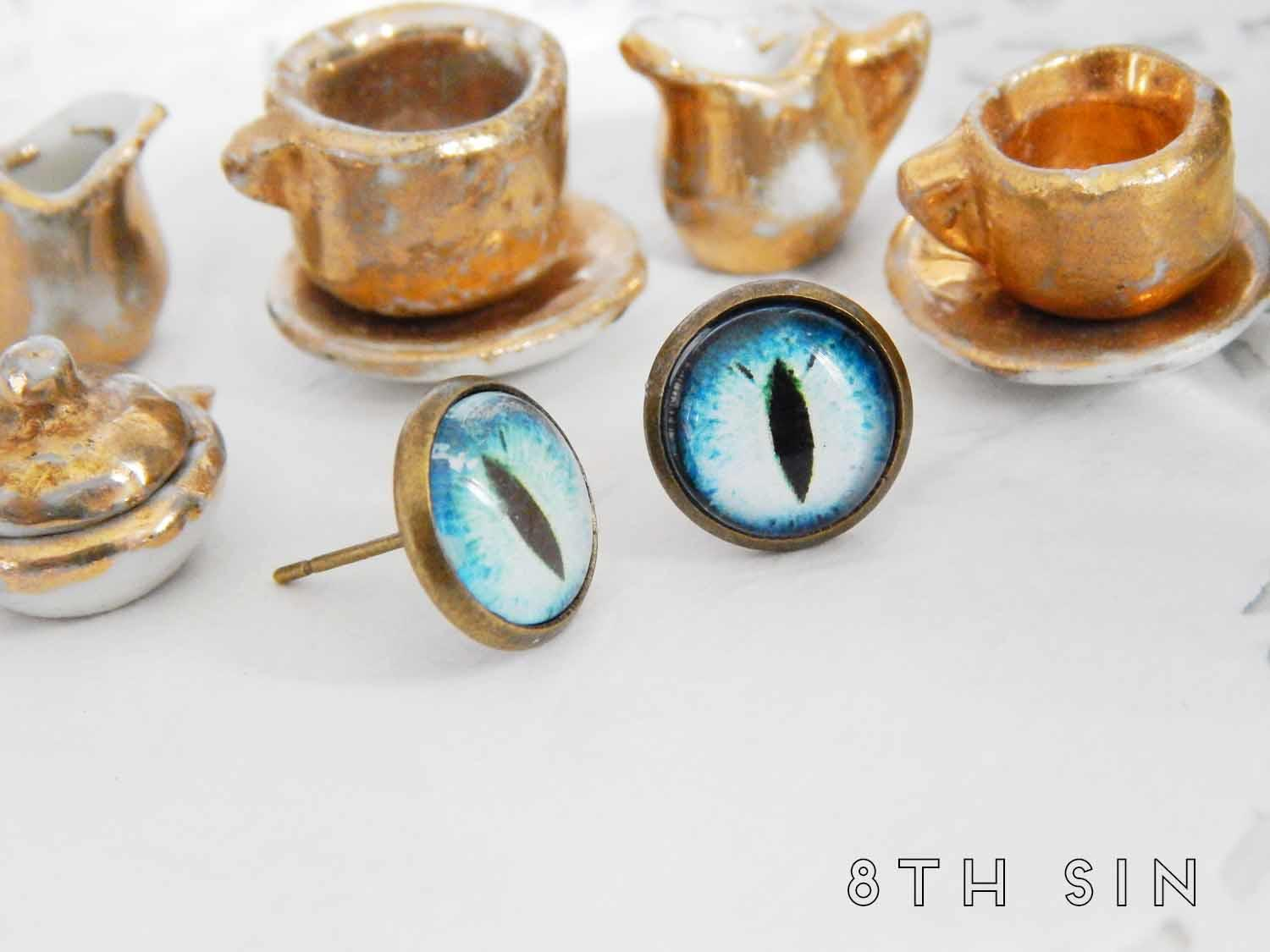antique bronze and blue dragon eye stud earrings