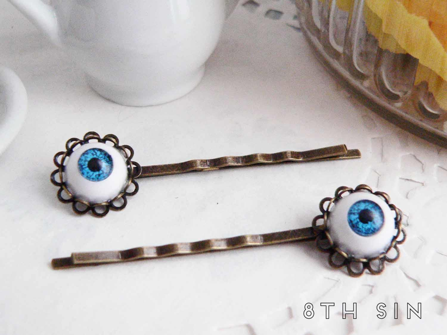 antique bronze and blue eye hair slides