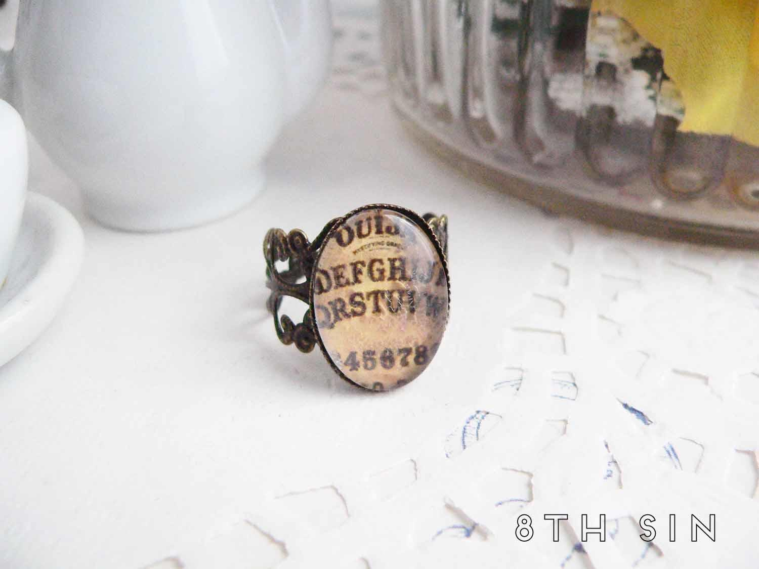 antique bronze and brown ouija board ring