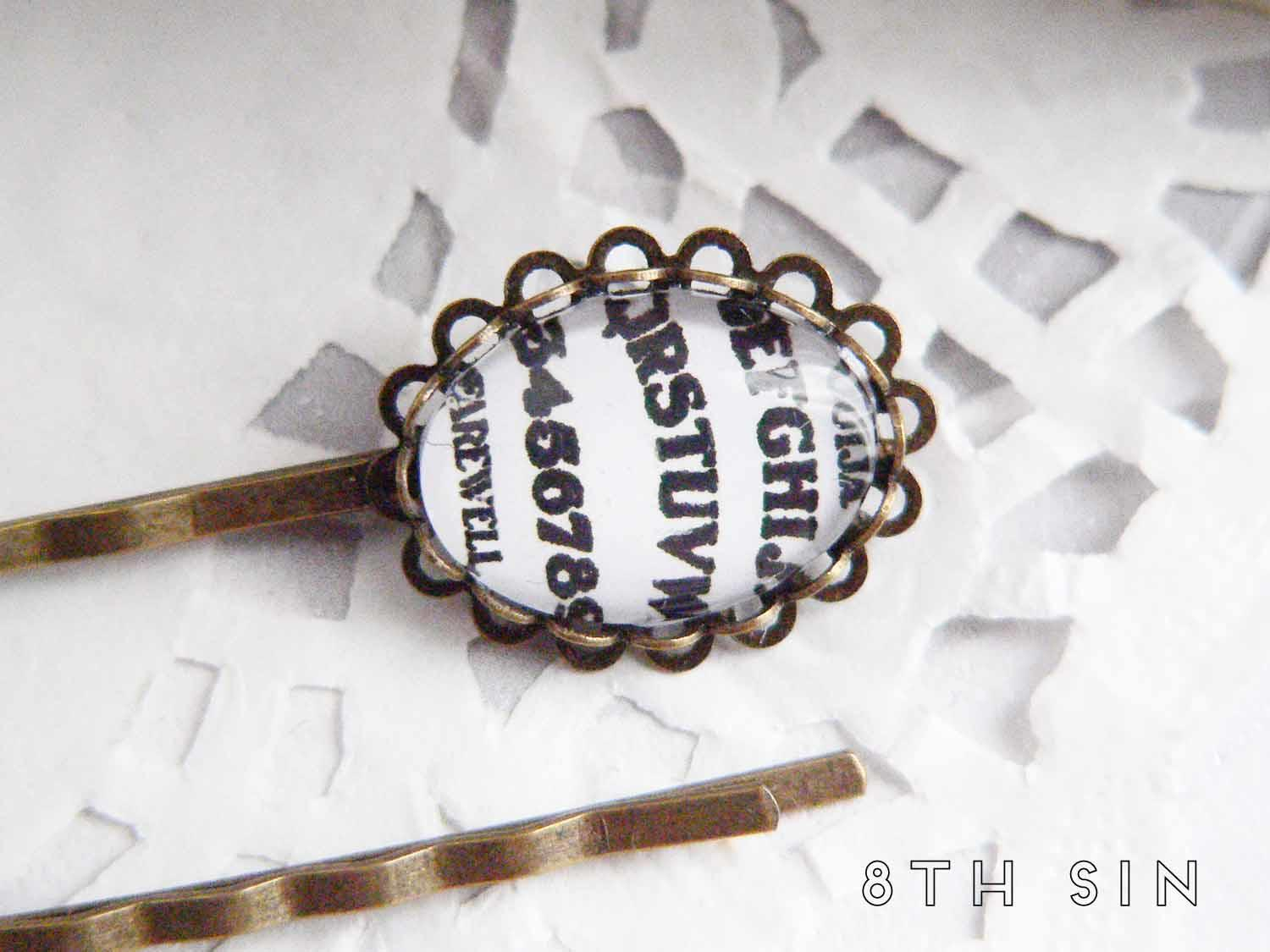 antique bronze and white ouija board hair slides