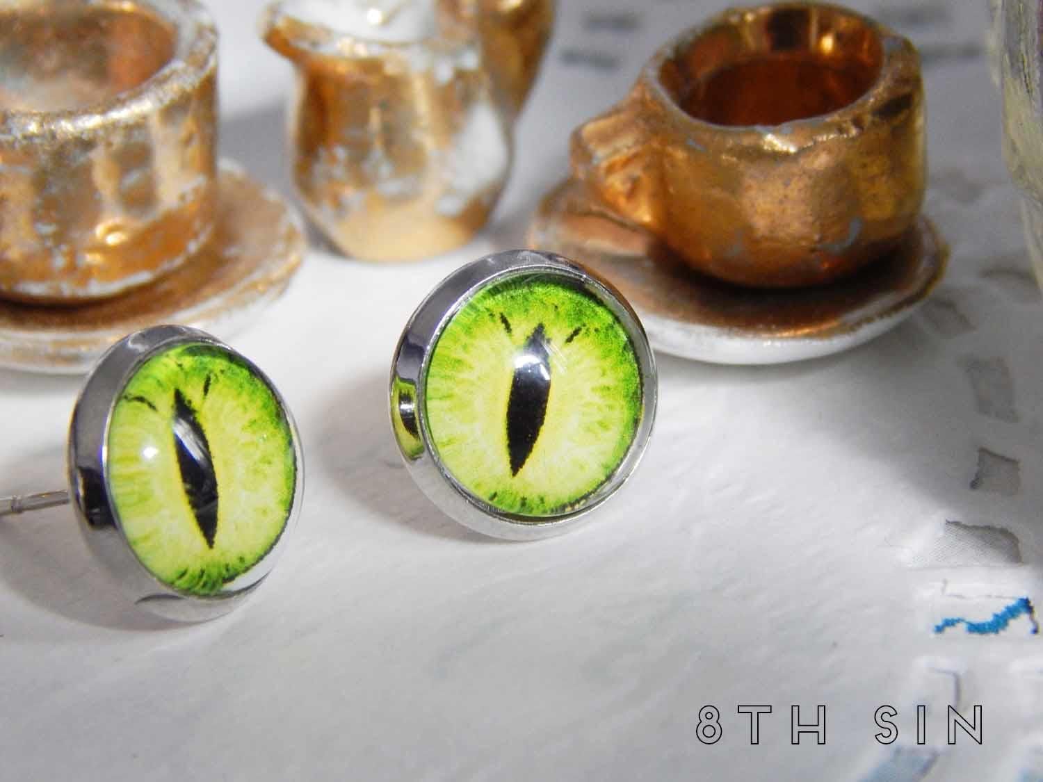 antique silver and green dragon eye stud earrings