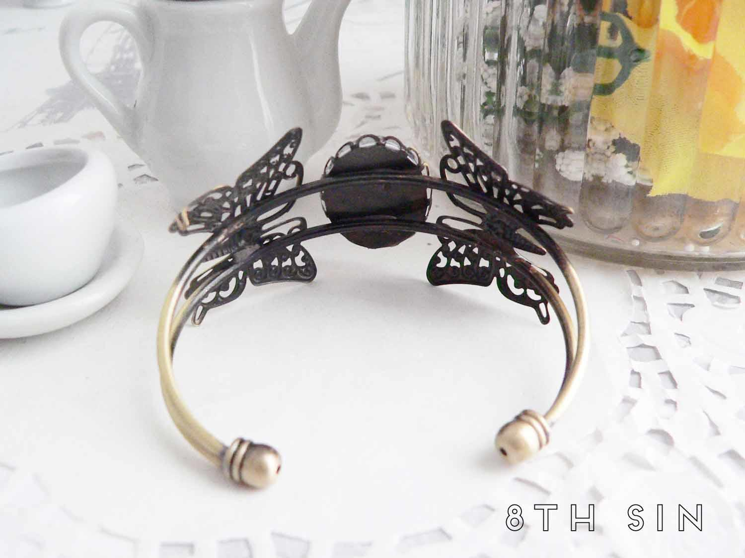 antique bronze raven bracelet