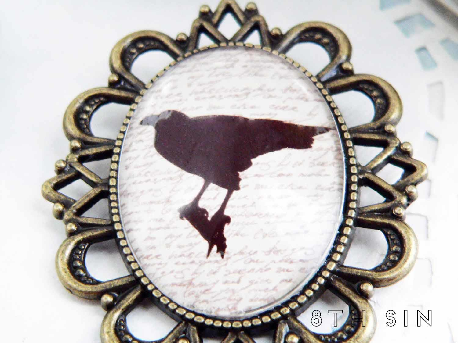 antique bronze raven brooch