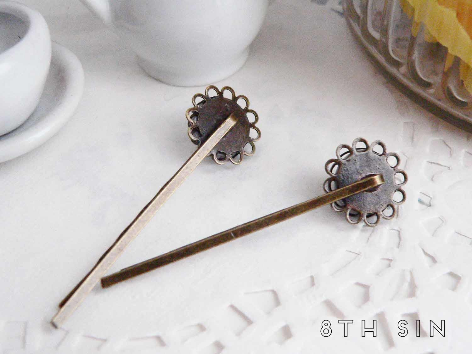 antique bronze clock hair slides