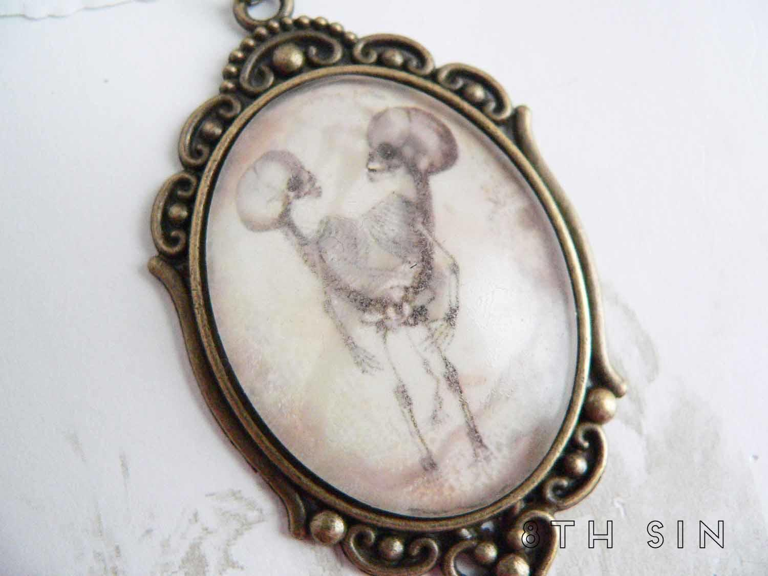 antique bronze conjoined twin necklace