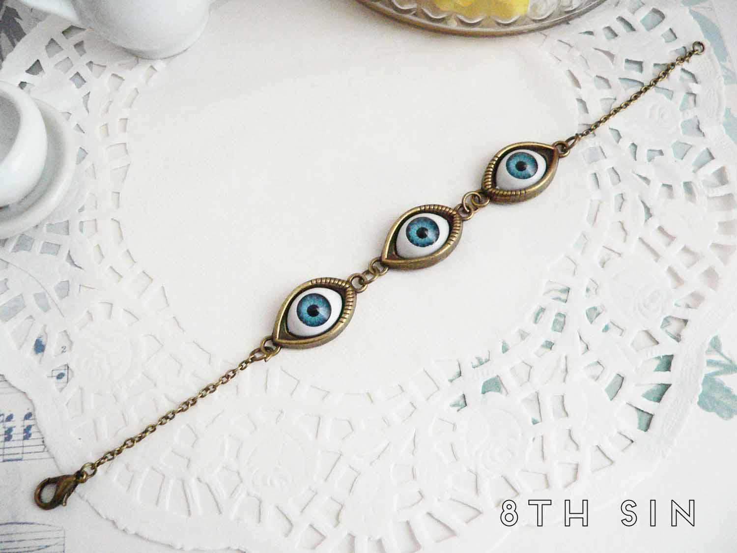 antique bronze and blue evil eye bracelet
