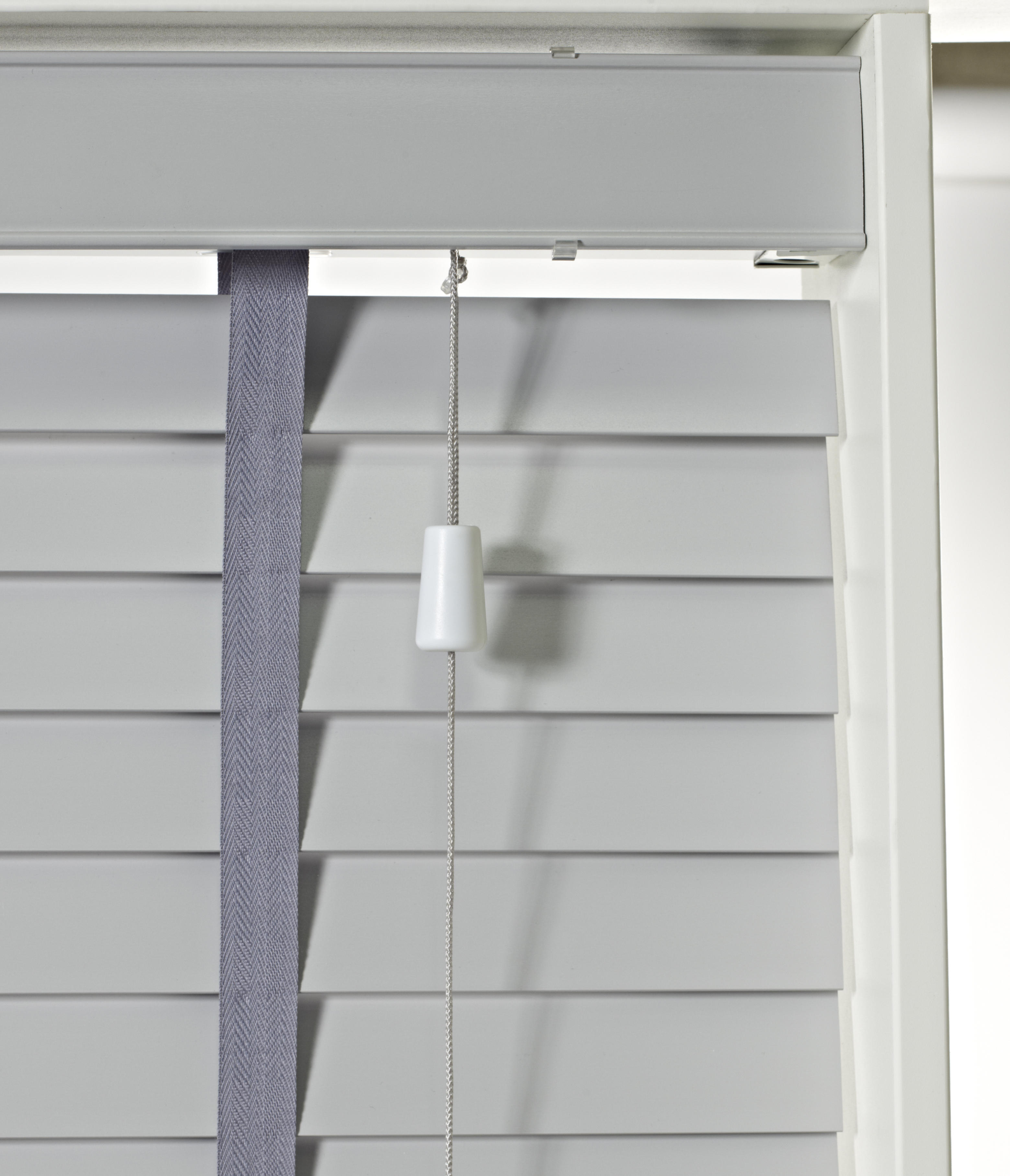 a window with a 50 mm slate grey styleline express wooden venetian blind with dark grey