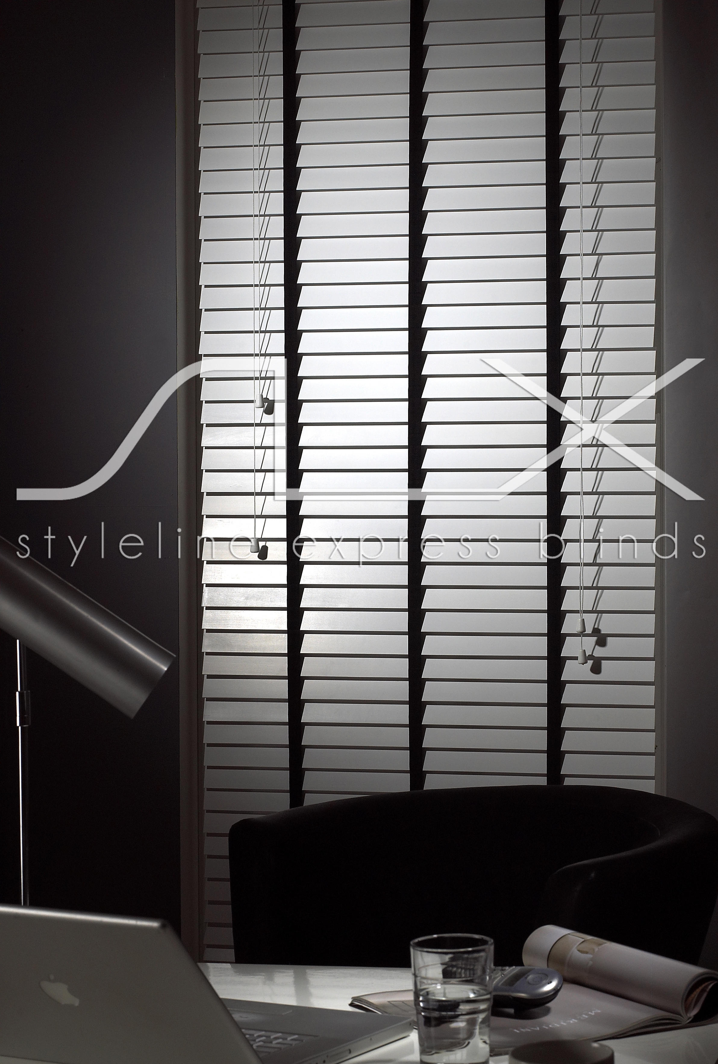 room set of a 50 mm white styline express wooden venetian blind with ebony ladder tapes