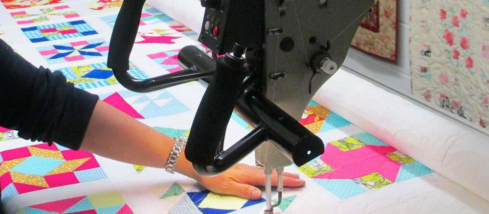 Professional long-arm quilting & basting for hand quilting