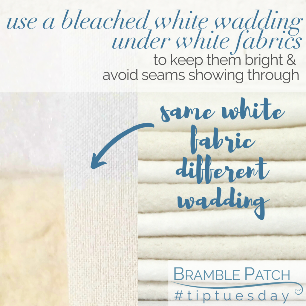 Use a bleached white wadding under white fabrics