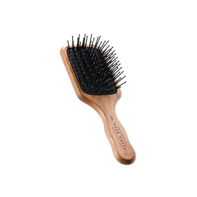 Pictured: The Pom Pin Kotibe Wood Travel Brush by ACCA KAPPA