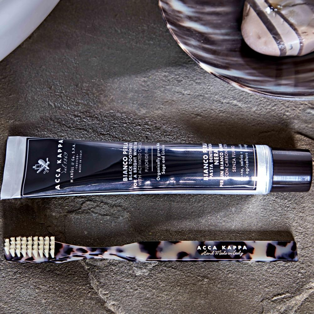 Pictured: The Activated Charcoal Toothpaste and Historical Black & White Toothbrush by ACCA KAPPA