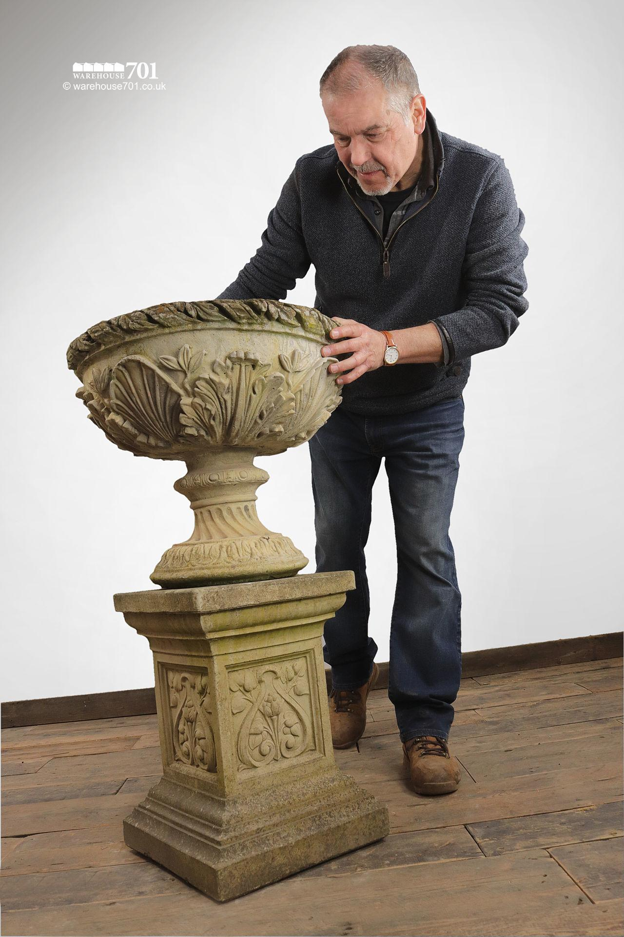 Pair of composite Floral Stone Urns on Plinths #5