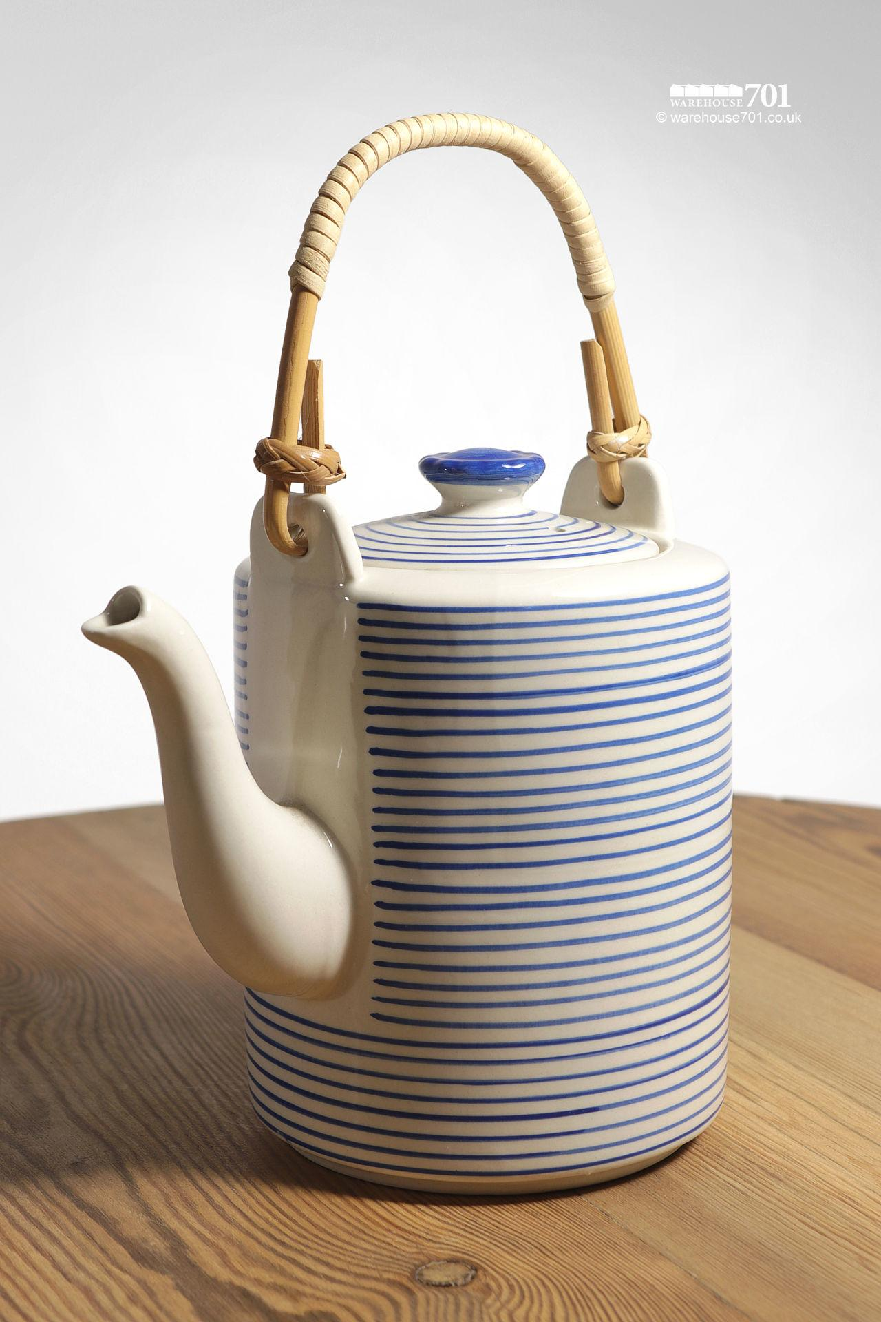 Blue and White Banded Ceramic Teapot with a Woven Bamboo Handle
