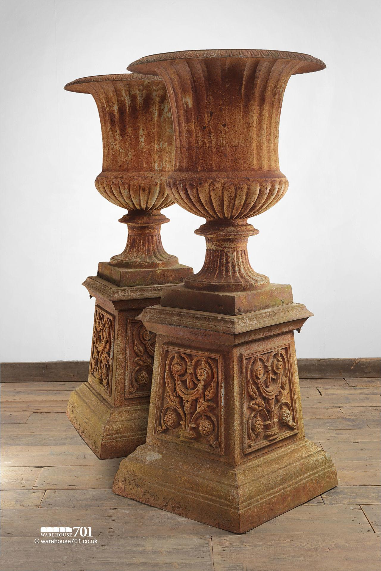 Pair of Aged Cast Iron Urns on Plinths