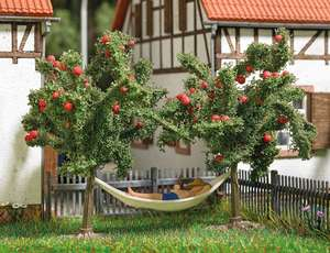 Busch 7863 Man lying in hammock with fruit trees