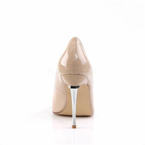 Cream Court Shoe with metal spike heels rear view