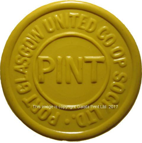 Co-op token, Port Glasgow  Pint (of milk) token. Yellow plastic.