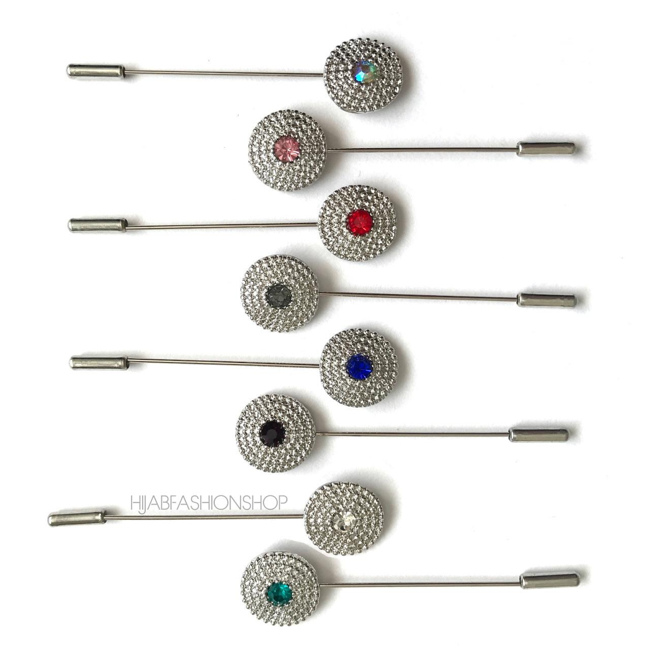 8 silver coin hijab pins with different coloured crystals in the middle