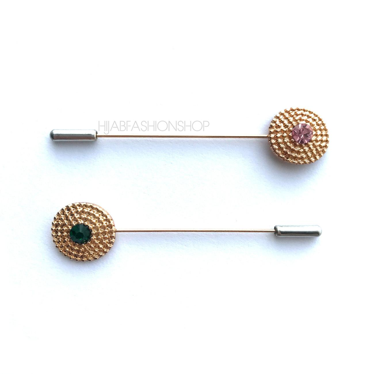 2 gold coin hijab pins with different colour crystals in the middle