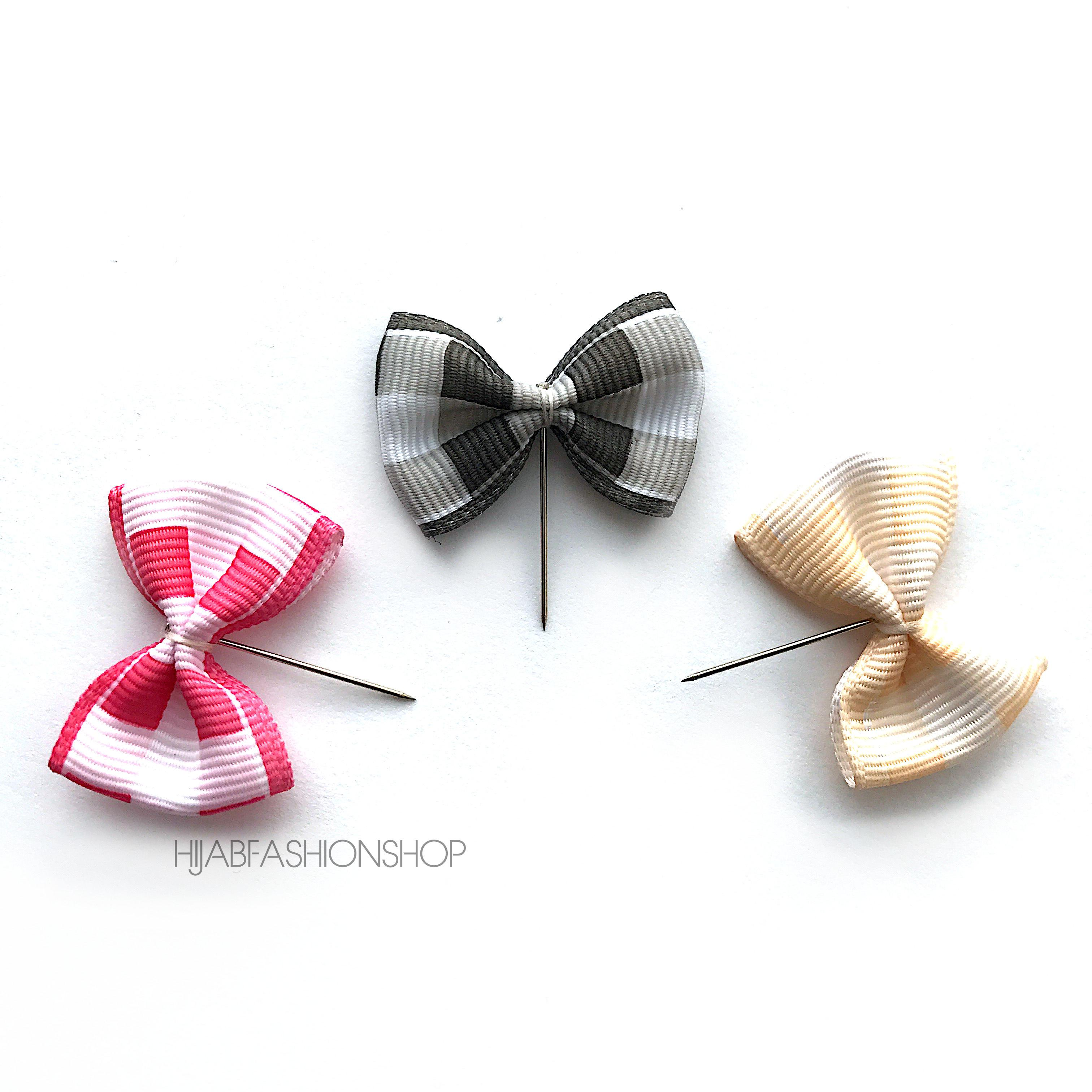 three checked bow hijab pins in red, cream and black