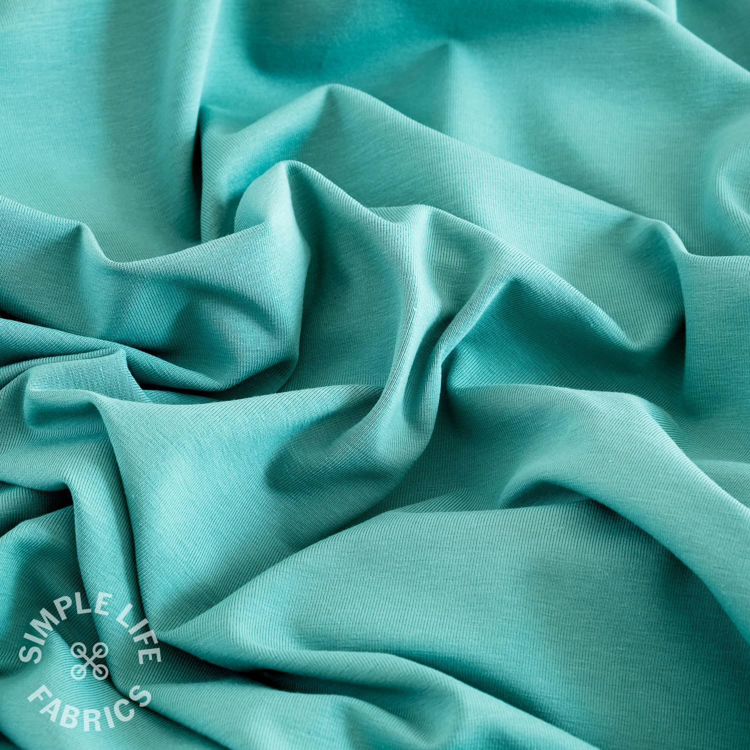 Organic plain solid green cotton jersey fabric