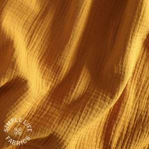 Mustard yellow plain organic cotton double gauze fabric