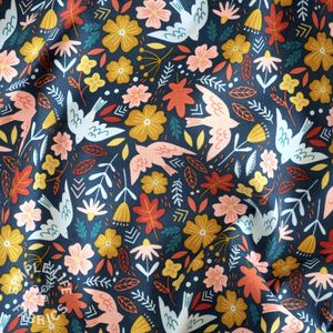 Babycord corduroy fabric with colourful birds flying navy