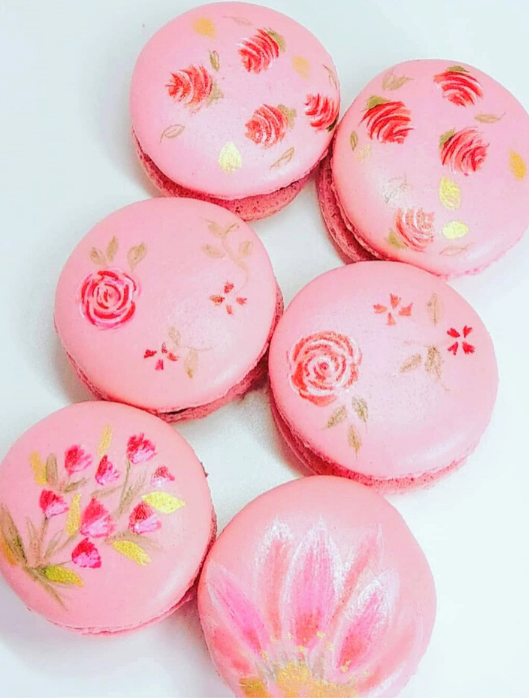pink and gold hand painted macarons