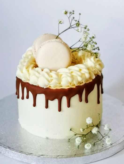 white drip cake with macarons london bendycocoa