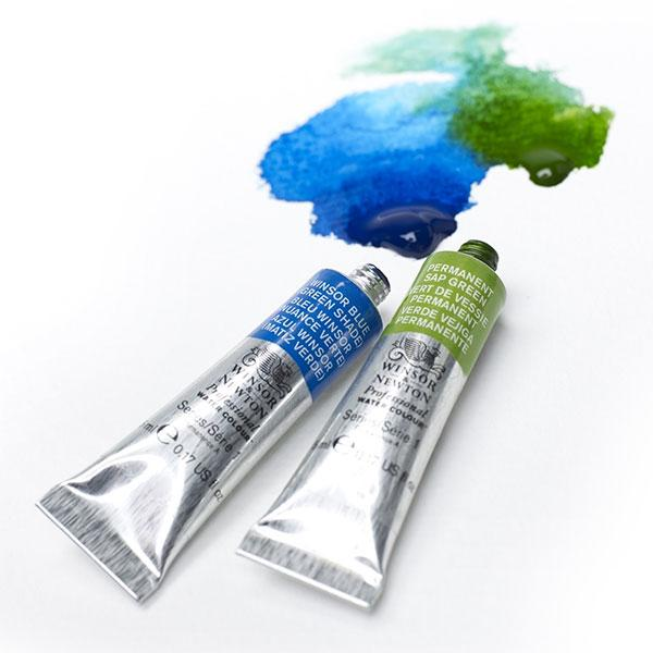 tubes of Winsor & Newton artist's professional watercolour paint with paint splashing out