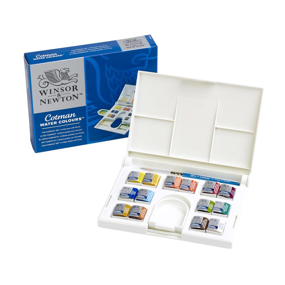 the interior of a Winsor and Newton Cotman Watercolours Compact Box with 14 half pans