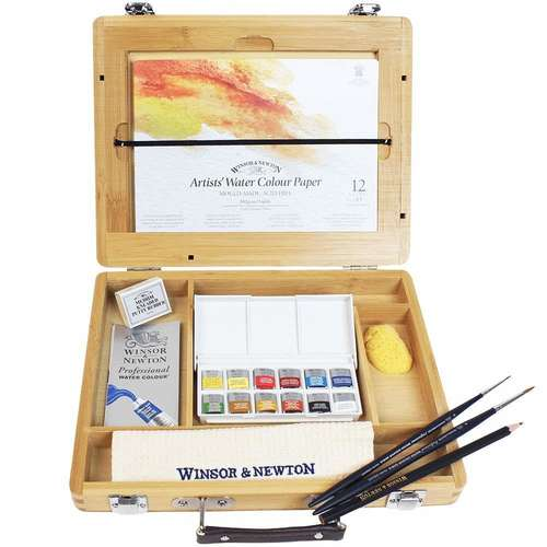 a wooden box set of Winsor and Newton artists watercolours with half pans