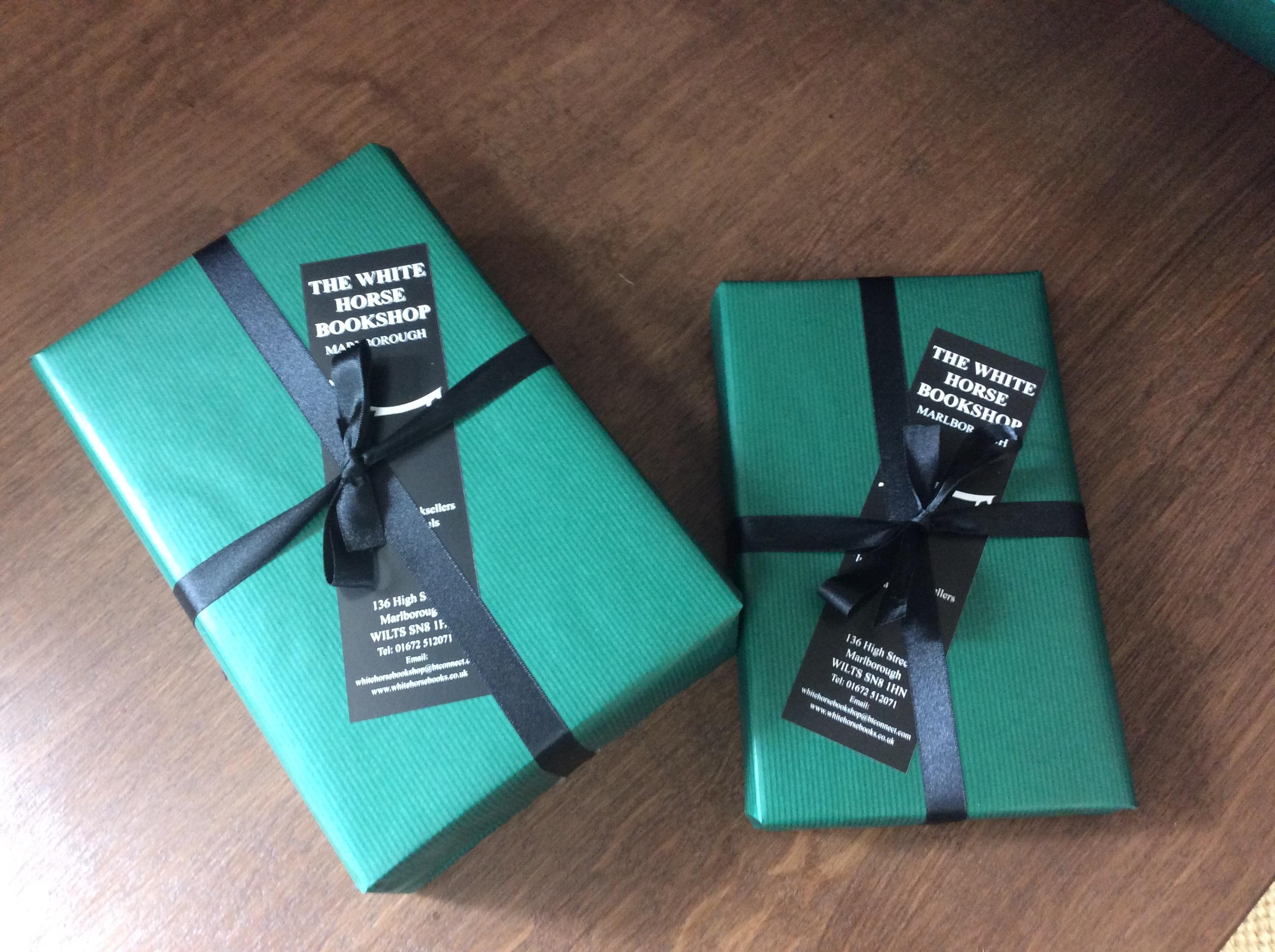 some green wrapped parcels with black ribbon