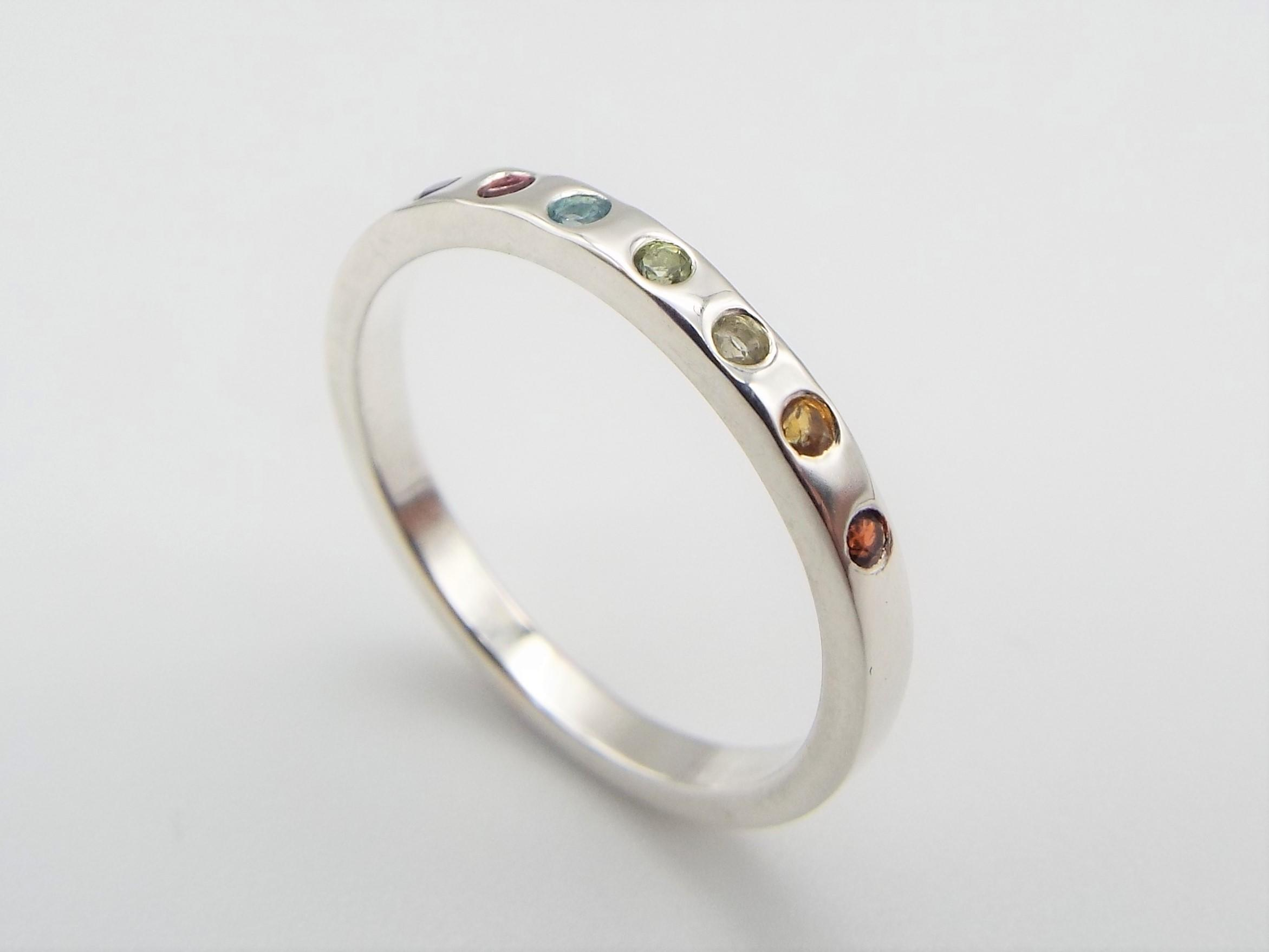 silver ring set with rainbow gemstones
