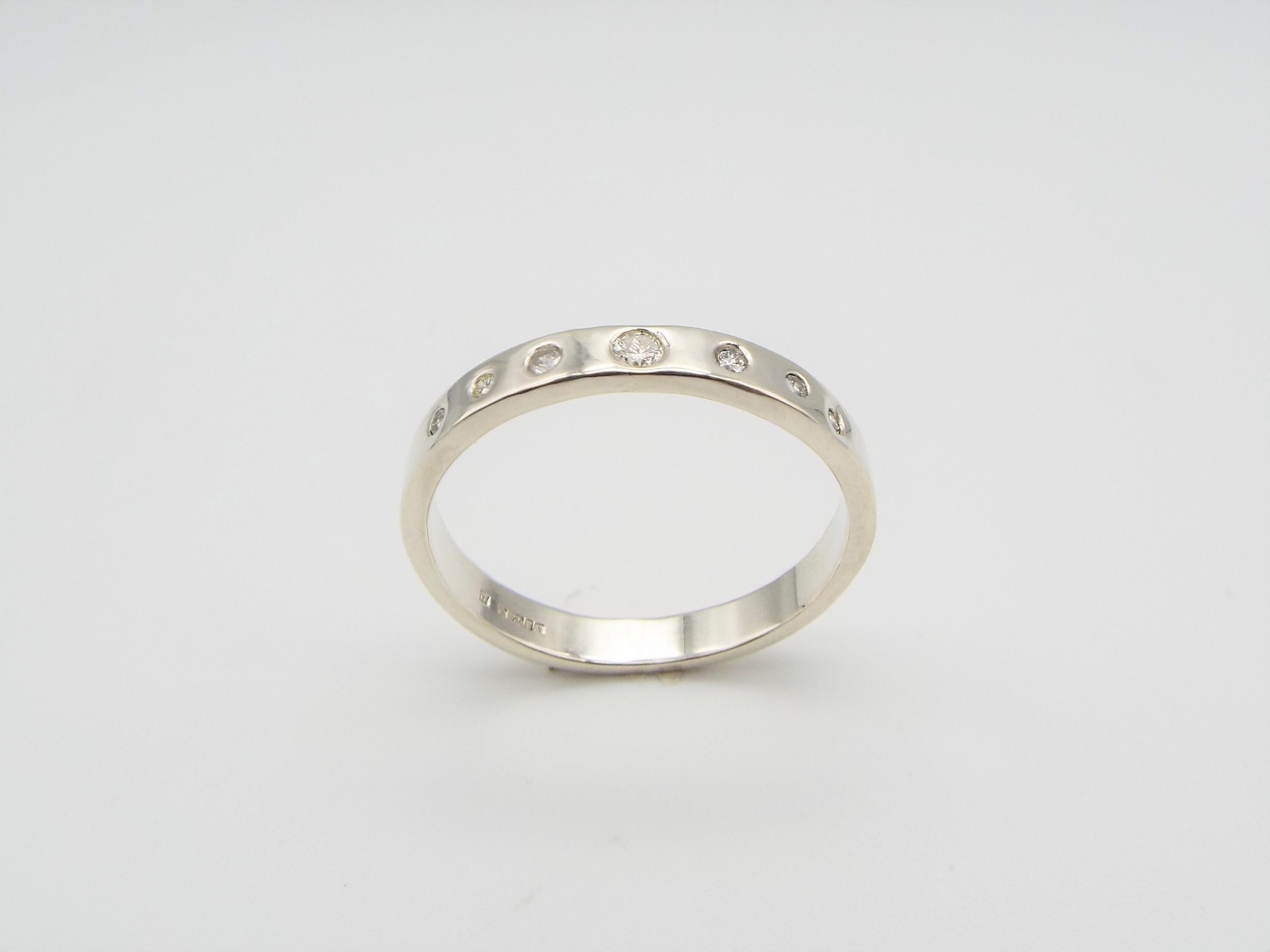 White Gold wedding ring with family diamonds
