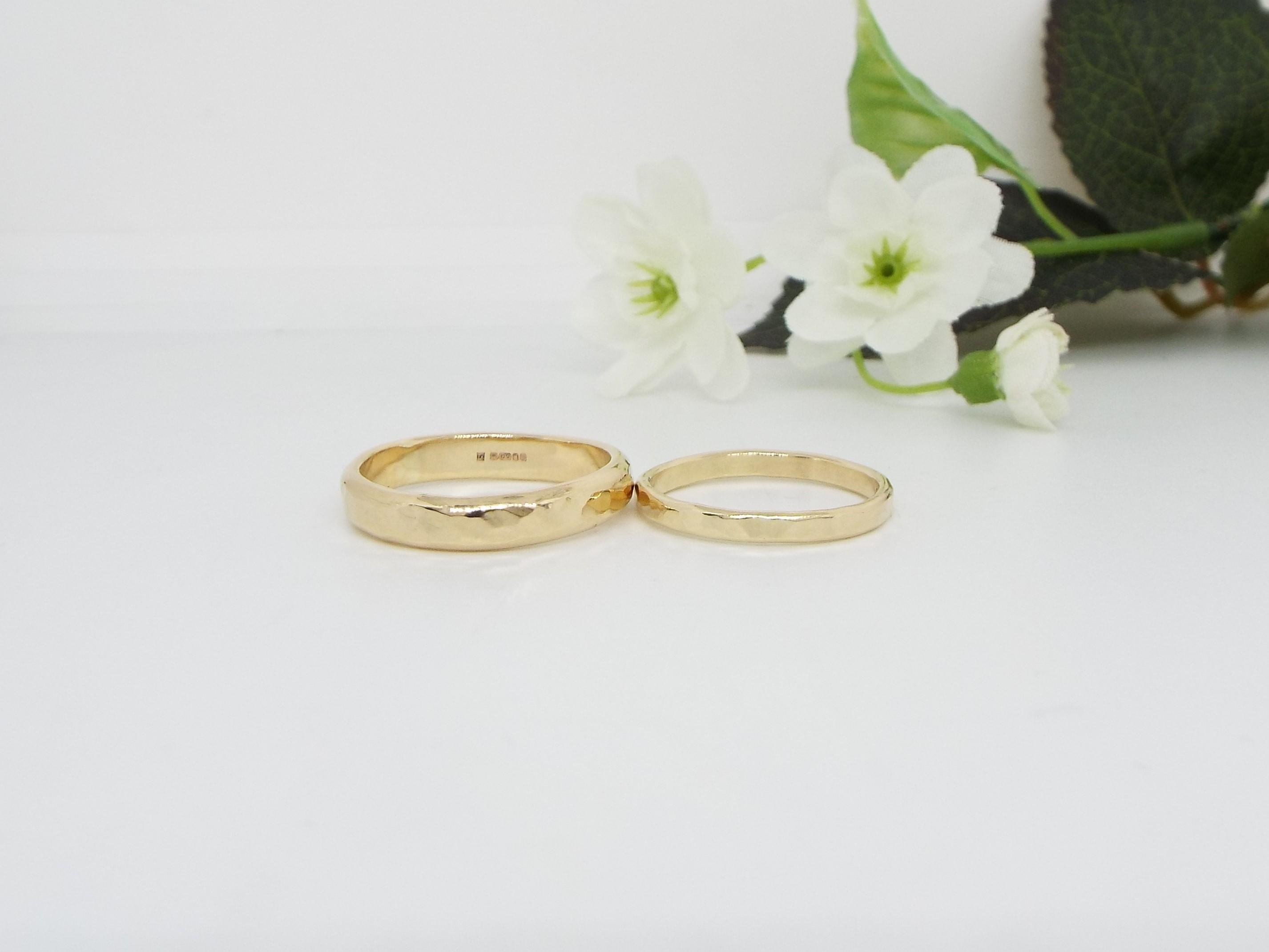 pair of gold wedding rings with hammered finish