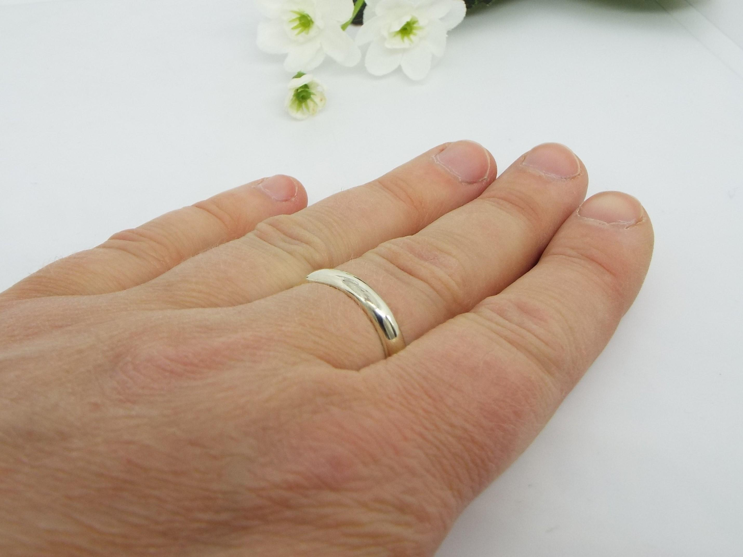 White gold wedding ring and hand