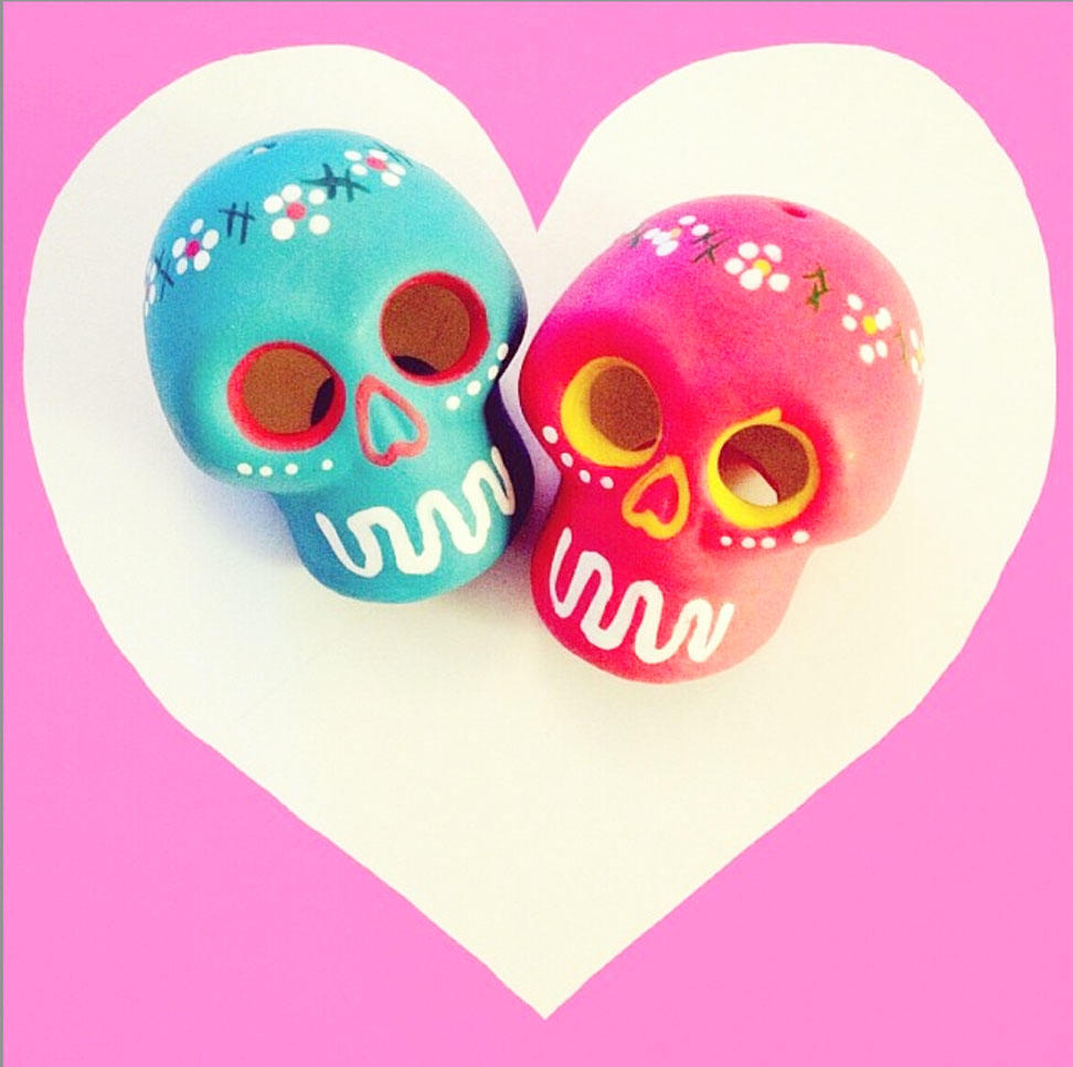 Two ceramic skulls in a heart